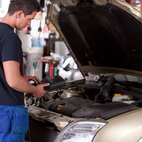 A Mechanic Runs a Diagnostic on a Car.