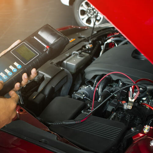 A Mechanic Tests a Car Battery.