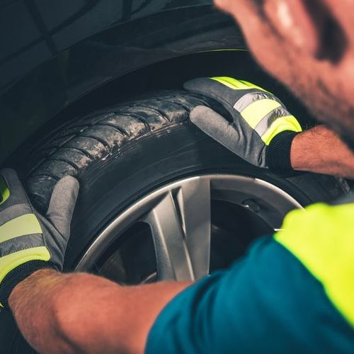 A Technician Checks a Tire.
