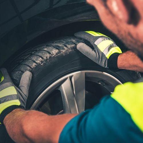 A Technician Checks a Tire.