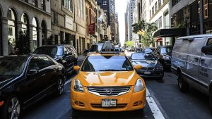 a photo of a taxi cab in traffic